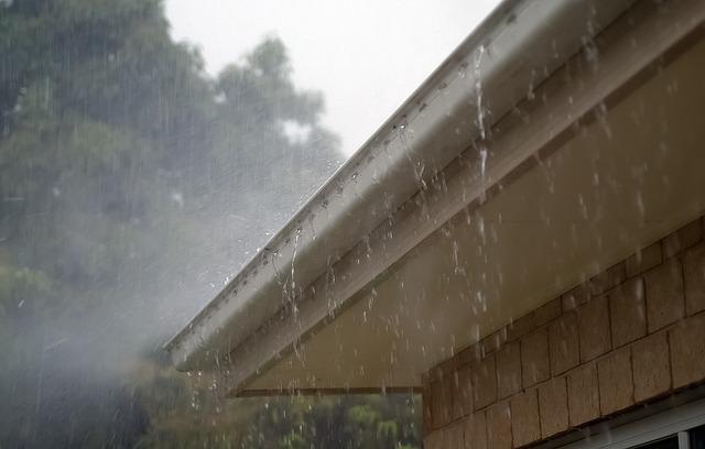 Gutters overflowing in rain